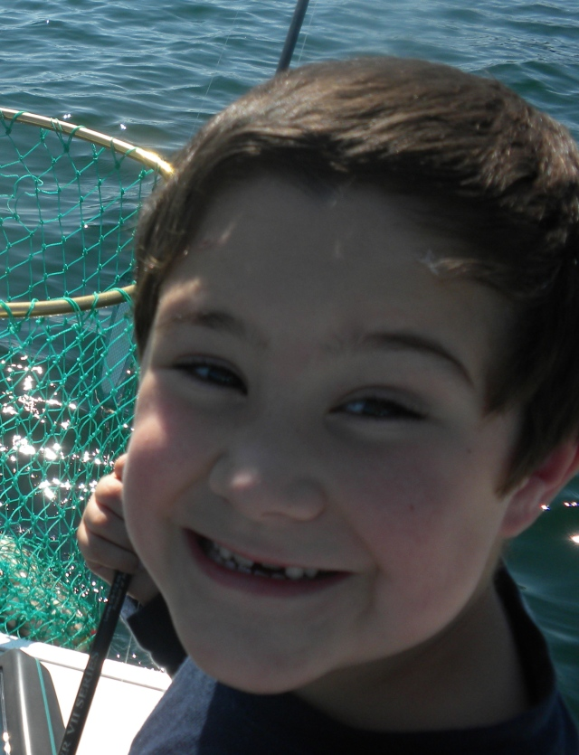 Justin, 7, catches a prize Mackinaw